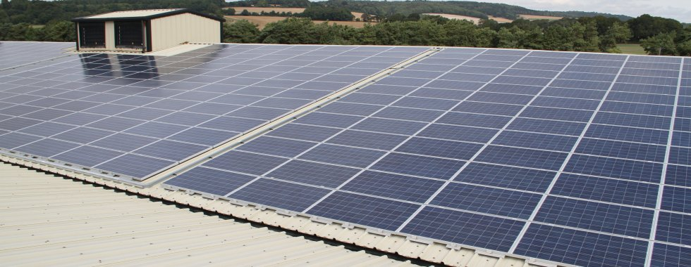 Solar panel installation on agricultural barn West Sussex